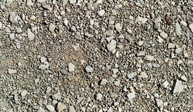 Repetitive pattern stones and gravel. Repetitive pattern of ground made of grainy small granular stones and gravel stock photography