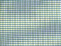 Repetitive textile background. Green, blue and white textile repetitive pattern royalty free stock photography