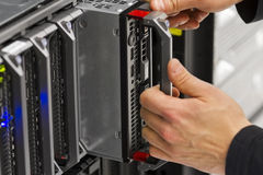 Replace Blade Server. Install or remove a blade server in a blade chassis in a rack. Shot in a data center Royalty Free Stock Photography