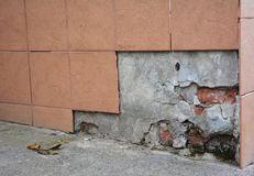 Replace, Repair Portions of Broken Porcelain Foundation House Wall. Tiles royalty free stock image