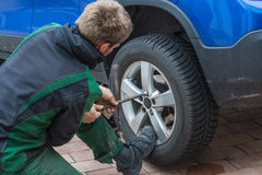 Replace summer tires against winter tires Stock Photos