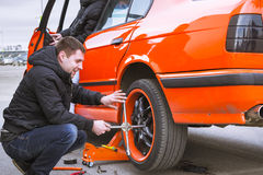 Replacement car wheels for old-car BMW 5-series e34. SAINT-PETERSBURG, RUSSIA - APRIL 5, 2014: Replacement car wheels for old-car BMW 5-series e34 at the meeting Stock Photos