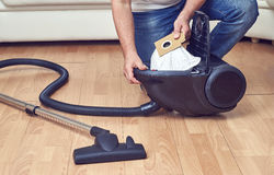 Replacement of a dust bag in vacuum cleaner Royalty Free Stock Image