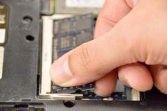 Replacement of memory. In the laptop, in one of the service centers for repair of laptops Royalty Free Stock Image