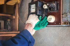 Replacement of the old electricity meter by a new one.  stock images