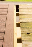 Replacement of old wooden deck with composite material Stock Image