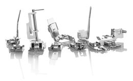 Replacement presser foot for household sewing machine isolated on white. Background stock photos