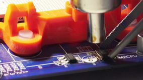 Replacement SMD element. On PCB plate with technology soldering hot air stock video footage