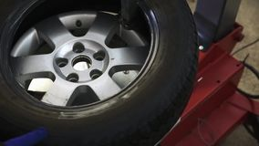 Replacement tires in service station stock footage