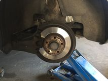 Brake disc of a car. Replacement of a whell in the workshop Royalty Free Stock Image