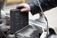 Replacing the air filter Stock Images