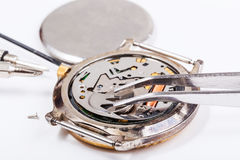 Replacing battery in quartz watch close up Stock Photography