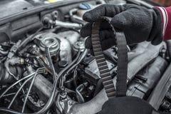 Replacing the belt. Car repair. Under the hood of the car. Stock Image