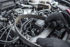 Replacing the belt. Car repair. Under the hood of the car. Stock Photos