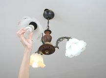 Replacing blown out light bulb Stock Images