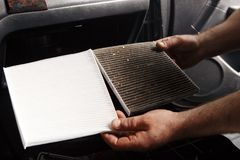 Replacing cabin air conditioner filter of car stock images