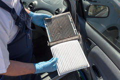Replacing the cabin air filter Royalty Free Stock Photo