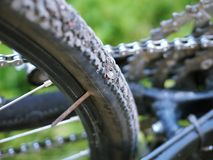 The puncture of the bike, replacing the camera on the bike, the hole in the wheel stock photography