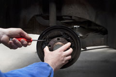 Replacing the car brake shoes Royalty Free Stock Images