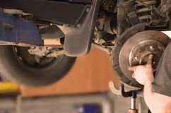 Replacing car brakes auto stock images