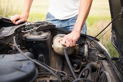 Replacing the coolant in the car. Maintenance Stock Photos