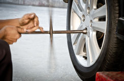 Replacing damaged wheel drive vehicle Stock Photography