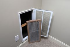 Replacing Dirty Air filter for home air conditioner royalty free stock photos