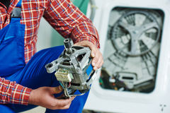 Replacing engine of washing machine Stock Image