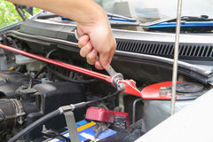Replacing front strut bar. Turn the wrench for Replacing front strut bar royalty free stock photography