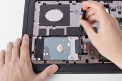 Replacing a laptop hard disk drive Stock Photography
