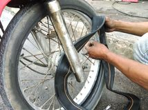 Replacing motorcycle tire Stock Photos