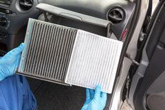 Dirty and clean cabin pollen air filter for a car stock photo