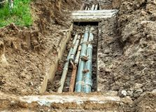 Replacing old worn-out water pipes within a residential area stock image