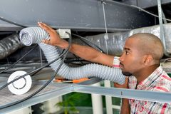 Replacing pipe in ceiling. Replacing pipe in the ceiling Stock Photography
