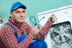 Replacing rubber drive belt of washing machine Royalty Free Stock Photo