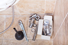 Replacing of rusted plumbing trap from sink Royalty Free Stock Photography