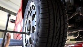 Replacing a tire. Automobile repair shop, replacing a tire stock video
