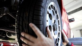 Replacing a tire. Automobile repair shop, replacing a tire stock footage