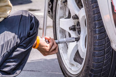 Replacing wheel vehicle Royalty Free Stock Image