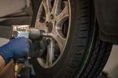 Replacing winter tires on summer tires in a professional garage with the help of professional tools. car on a hydraulic. Replacing winter tires on summer tires stock photo