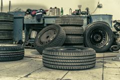Replacing winter tires on summer tires in a professional garage with the help of professional tools. car on a hydraulic. Replacing winter tires on summer tires royalty free stock images