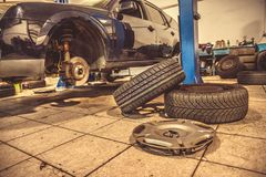 Replacing winter tires on summer tires in a professional garage with the help of professional tools. car on a hydraulic. Replacing winter tires on summer tires stock photos