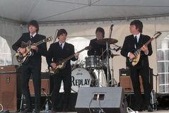 Replay the beatles. The beatles impersonators in performance on stage at the pointe a calliere museum stock photos