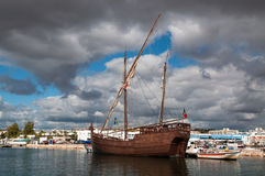 Replica of the caravel of Columbus. A replica of the caravel of explorer Christoffer Columbus that is laying in the harbor of Lagos in Portugal Stock Photo