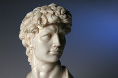 Replica of David. Replica sculpture of David iver a blue background Royalty Free Stock Image