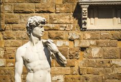 Replica of David statue of Michelangelo in front of Florence Palazzo Vecchio in Florence, Italy. Architecture and landmark of Florence Stock Photo