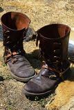 Replica of historical medieval leather splatterdashes boots with spurs displayed on medieval festival Royalty Free Stock Images