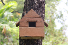 Replica house of squirrel animal on a tree in the garden. Stock Image