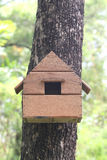 Replica house of squirrel animal on a tree in the garden. Royalty Free Stock Image