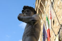 Replica of Michelangelo`s David statue against blue sky, Florence, Italy Stock Images